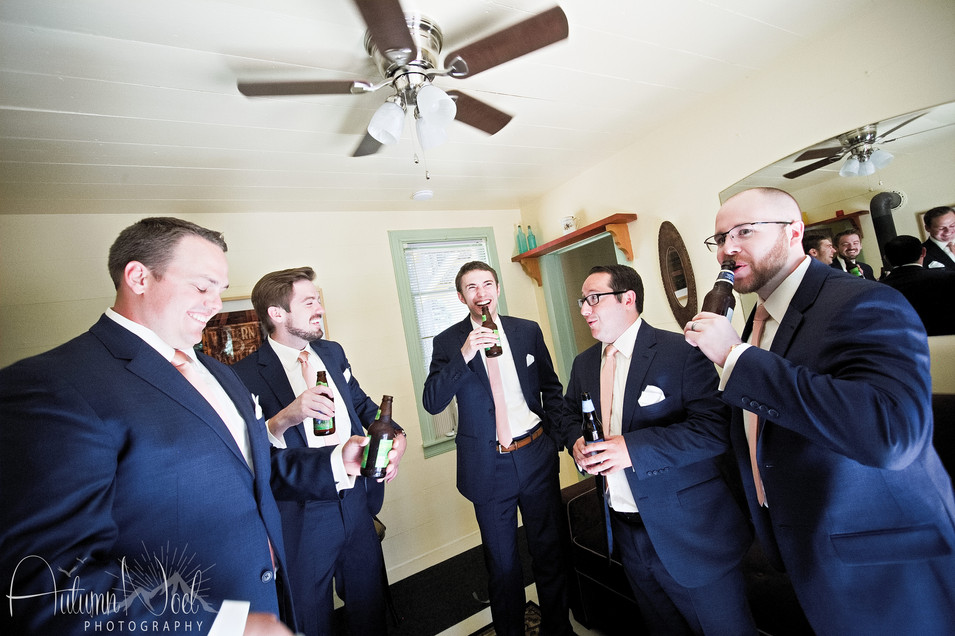 groom and groomsman getting ready