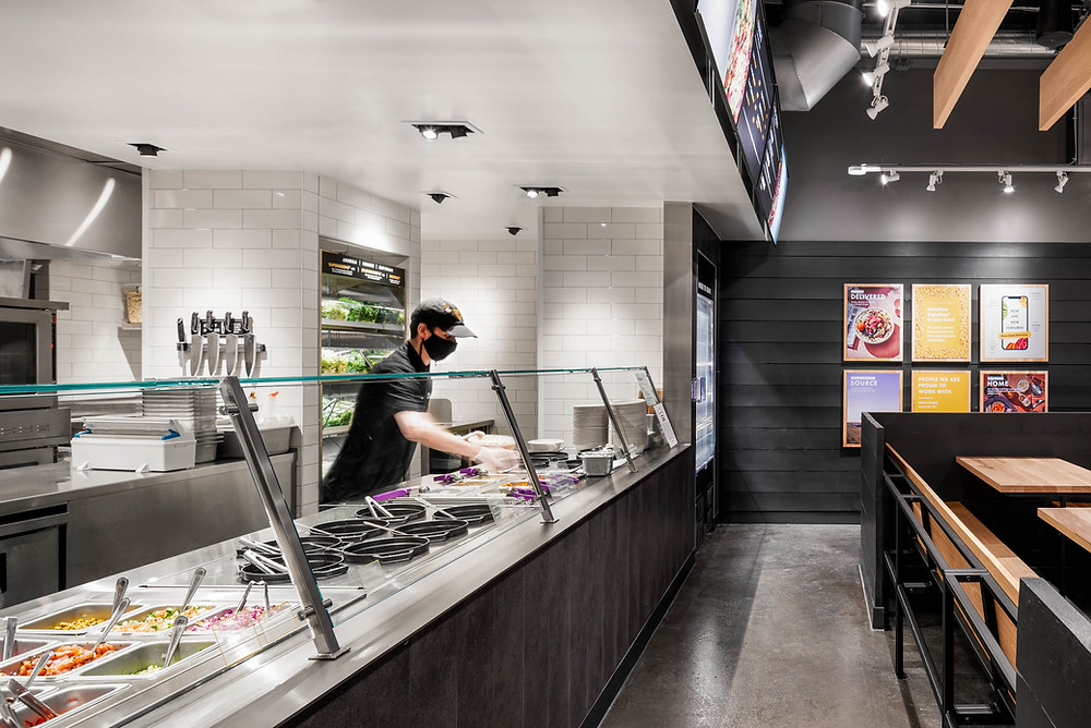 Restaurant server dishing up food