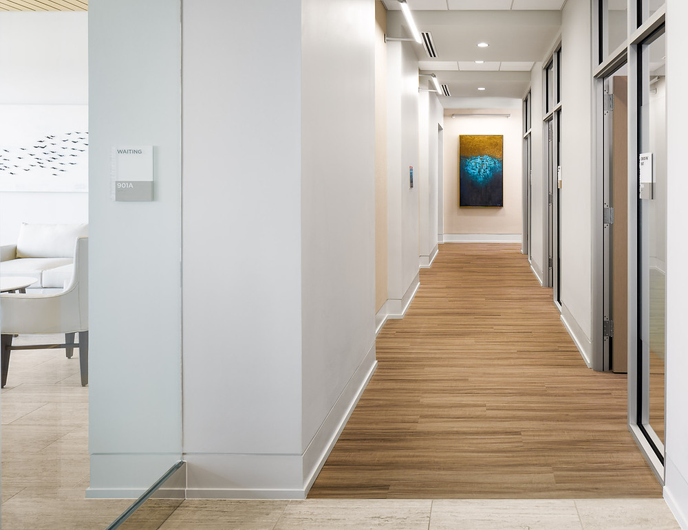 Upscale Doctors Office Hallway, wood floors, artwork