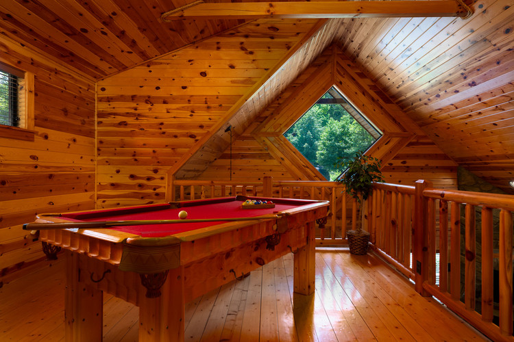 A log cabin loft with a pool table in it from Gatlinburg TN