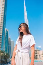 happy-woman-walking-in-dubai-with-burj-k