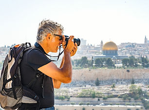 man-photographing-tourists-in-jerusalem-