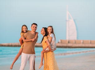 happy-family-on-the-beach-during-summer-