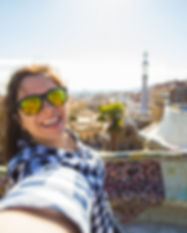 young-woman-making-selfie-in-park-guell-