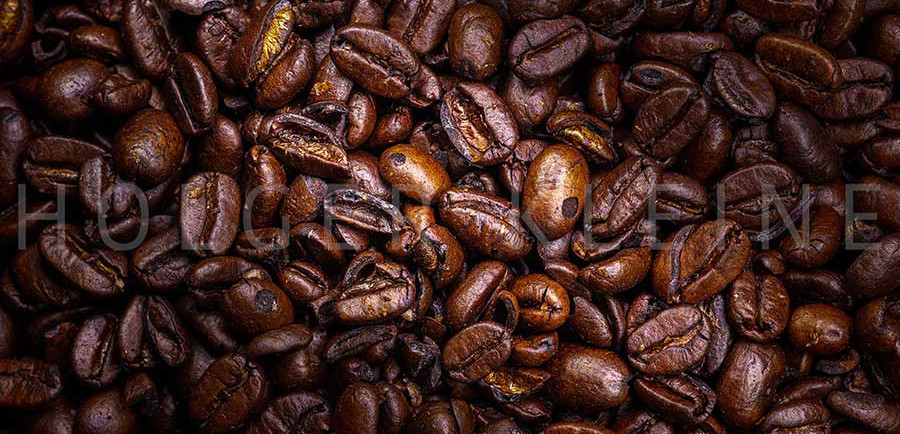 Close up to a heap of roasted coffee beans
