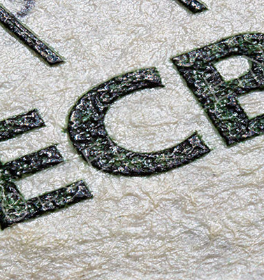 macro photography of a five euro banknote