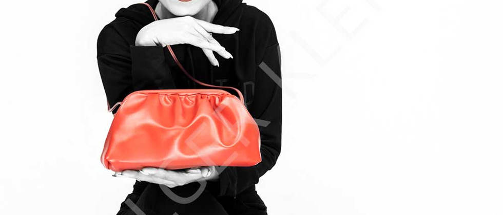 Black and white photography of Asian woman with handbag