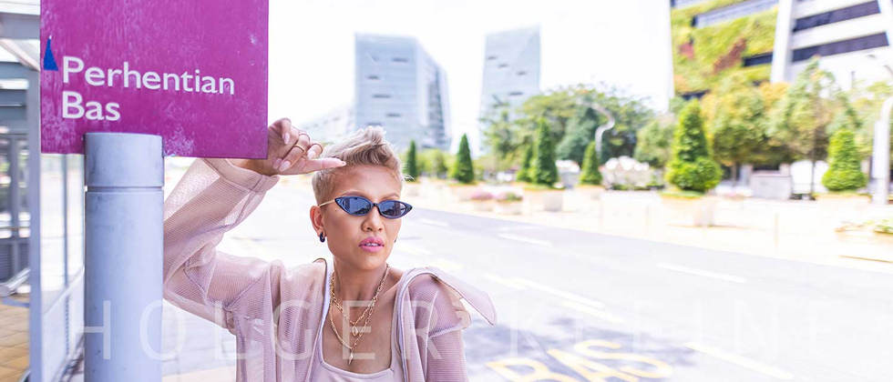 Asian woman with a black sunglasses at a bus stop