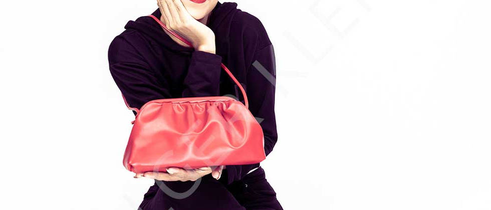 Young Asian woman with red handbag