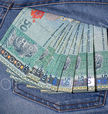 Bunch of fifty ringgit in a female jeans pocket