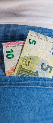Five and Ten Euro in a sexy female pants pocket