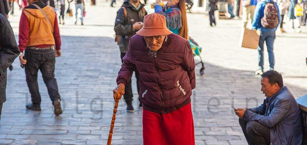 Old Tibetan man with walking stick