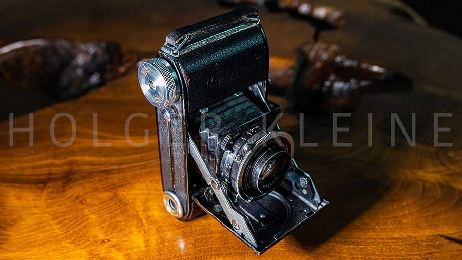 Old scratched and dusty antique photo camera