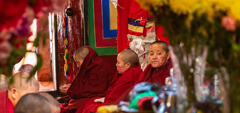 Female Buddhist nuns or novices in a Jokhang monastery