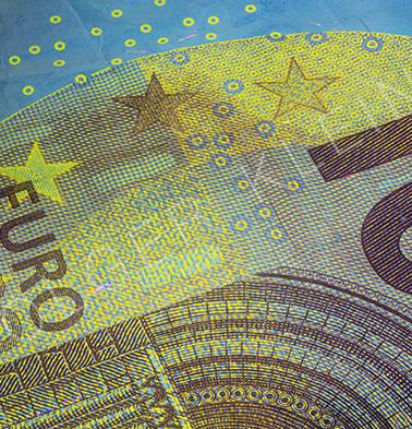 Close-up macro image of European money illuminated with Fluor light.