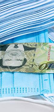 Face masks and Pula of Botswana on white background