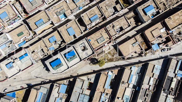 A aerial view over a small Tibetan village
