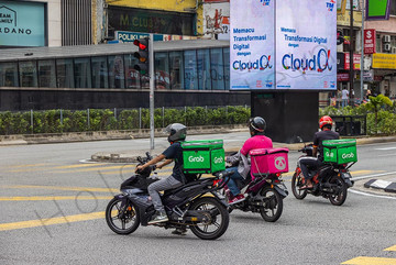 Grab food delivery rider on the motorbike