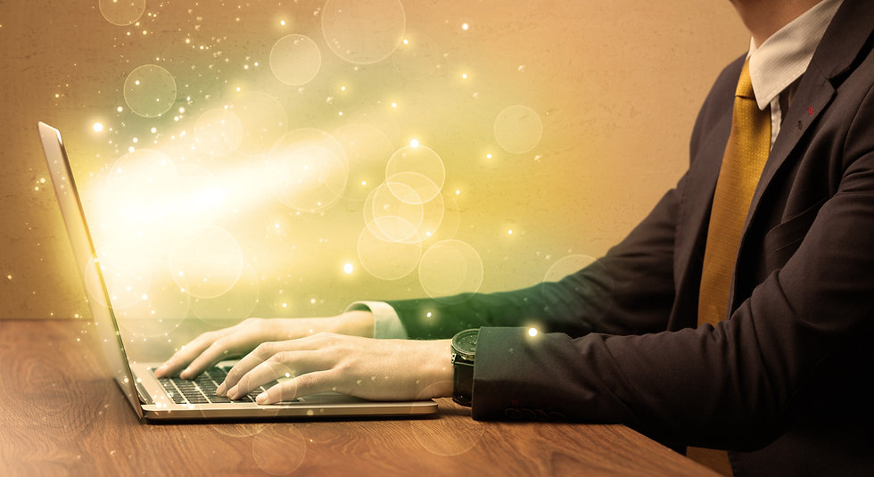 An elegant businessman sitting at desk a