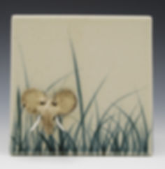 "1) Elephant in the Grass, 6"", stoneware. The image pops out from the tile surface."