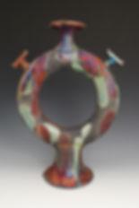 "14) Raku Doughnut Vase, 16"" tall."