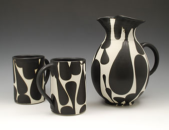 "1) B/W Pitcher with Mugs, 9"" tall."