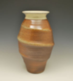 "7) Soda Fired Tornado Vase, 13"" tall, stoneware."