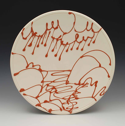 "4) Slip Trailed Plate, 10""dia, Lowfire white ware with terrcotta slip."