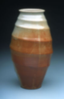"5) Tornado Vase, 18"" tall, Stoneware with Shino glaze."