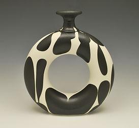 "30) B/W  Doughnut Vase, 10"" tall."