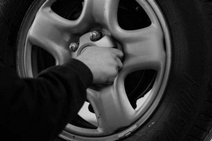 Auto Technician Repairing Tire and Wheel