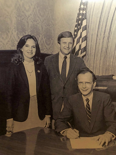 Gloria Freeman and Jerry Beasley with S.C. Gov. Dick Riley during the signing of the Proclamation of Textile Week in the early 1980s.