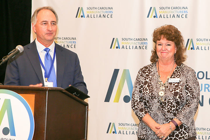 Gloria Freeman is recognized for 40 years of service at the SCMA's Annual Meeting in 2018 by SCMA Chairman Kurt Dallas of AFL.