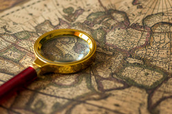 retro-magnifier-with-old-map-PDVAEF7