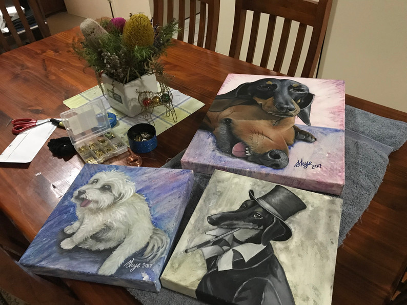 Table full of paintings.