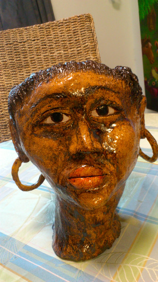 Gaint clay head African lady