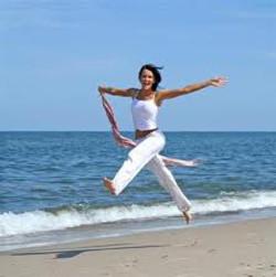 Woman jumping beach