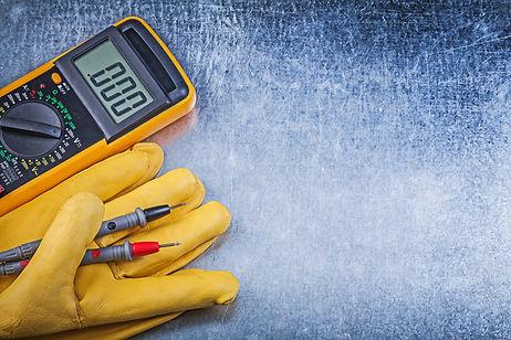 Digital electric tester safety gloves on