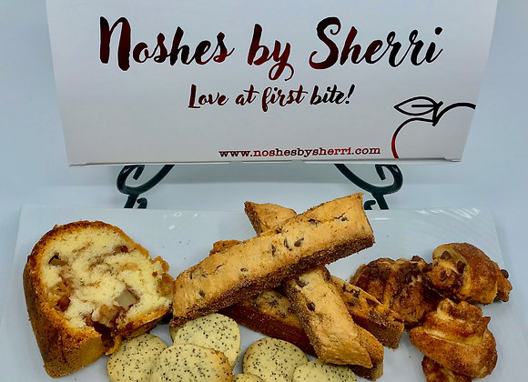 combination of our top noshes! jewish apple cake, chocolate chip mandel bread, poppyseed cookies and rugelach