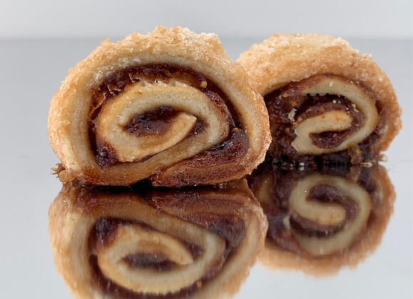 Raspberry Rugelach coated in cinnamon sugar. Perfect pastry to satisfy your cravings.