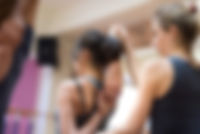 Young women practicing yoga at the gym a
