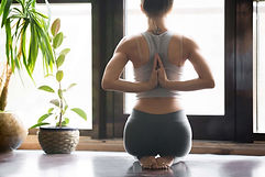 Young woman practicing yoga with namaste