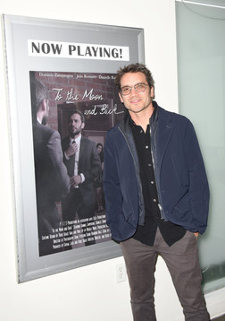 Dominic Zamprogna posing with the film's poster