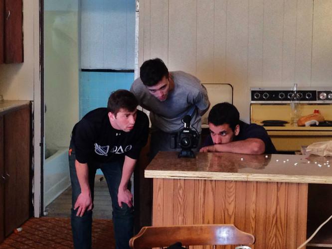 DoP Vincent Derise, star Greg Fenton, and Writer/Director Nate Hapke watching back a take on set.