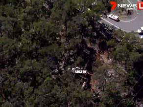 Lucky escape for truck driver who crashes over barrier at Wisemans and tumbles vehicle down cliff