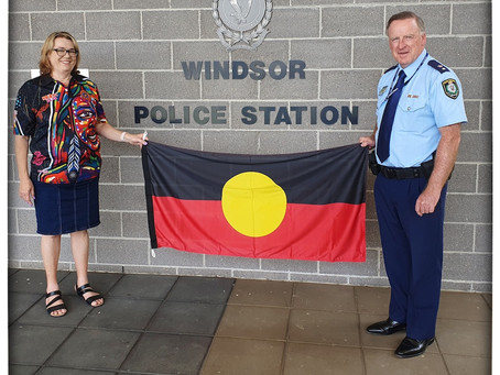 Hawkesbury Police gifted with Aboriginal Flag in sign of closer cooperation