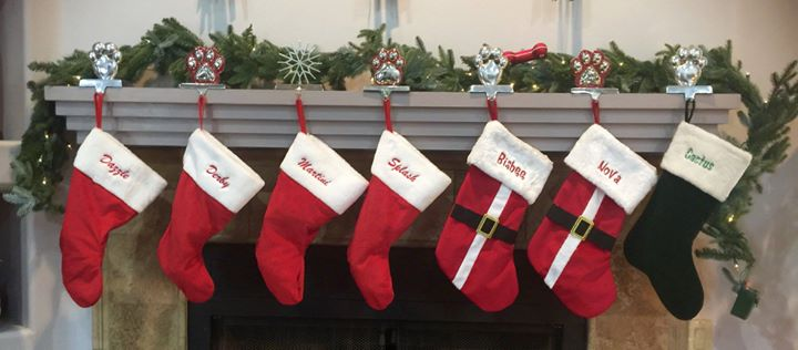 The stockings are hung by the Chimney wi