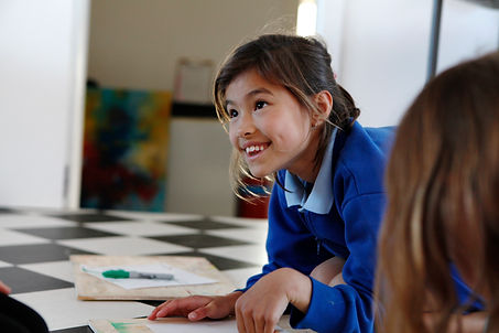 Girl smiling and enjoying being creative