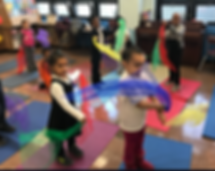 an image of kids in movement class with scarves