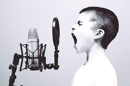 boy%20singing%20on%20microphone%20with%2